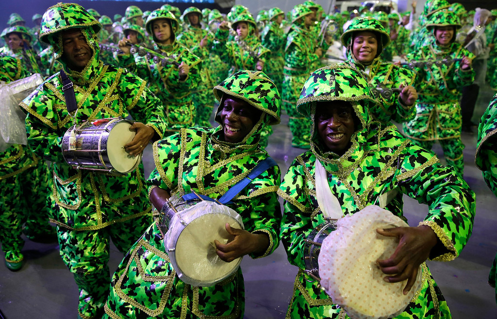 Description of . Drummers from the Academicos do Tucuruvi samba school perform during a carnival parade in Sao Paulo, Brazil, Saturday, March 1, 2014. (AP Photo/Andre Penner)