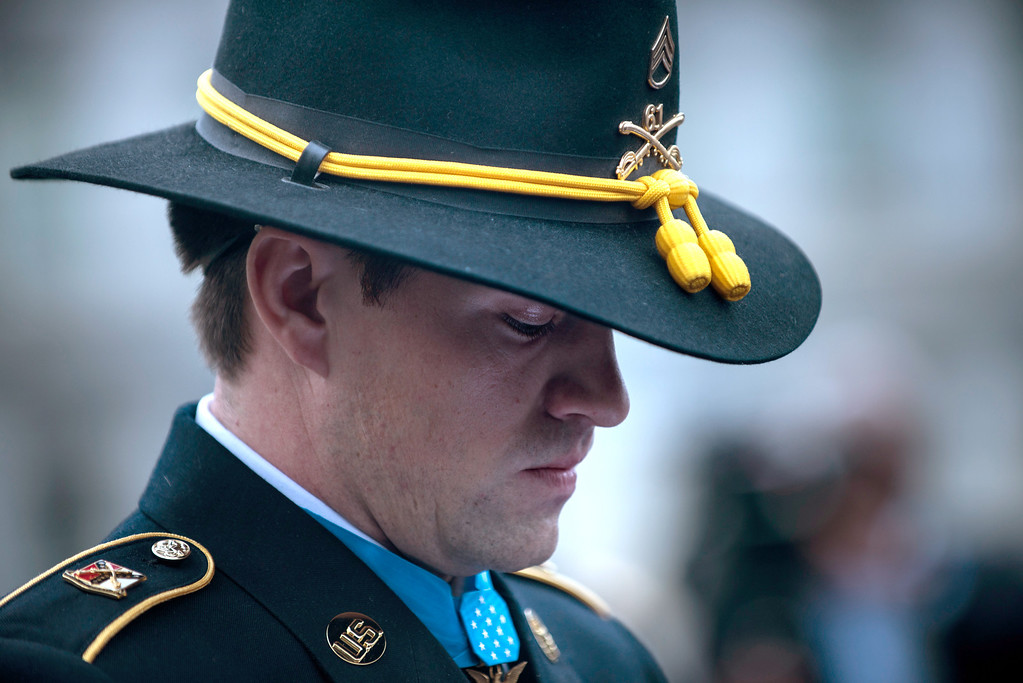 Description of . Former US Army Staff Sargent Clinton Romesha pauses while speaking to the press outside the West Wing following his  Medal of Honor ceremony at the White House February 11, 2013 in Washington, DC. AFP PHOTO/Brendan SMIALOWSKI/AFP/Getty Images