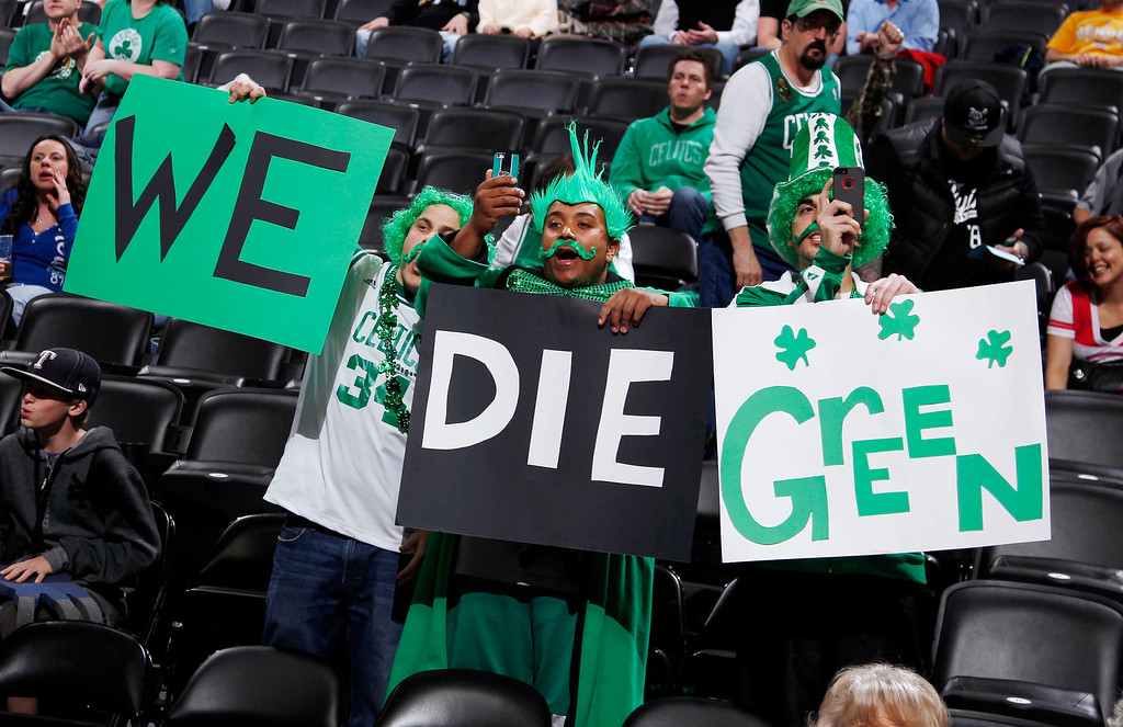 Description of . Boston Celtics fans hold placards as their team takes the court to face the Denver Nuggets in an NBA basketball game in Denver on Tuesday, Feb. 19, 2013. (AP Photo/David Zalubowski)