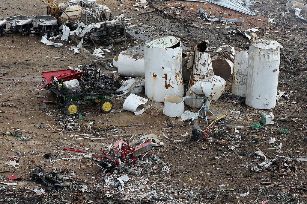 Description of . WEST, TX - APRIL 18:  A destroyed fire truck sits among piles of rubble where an explosion at the West Fertilizer Company leveled the business a day earlier April 18, 2013 in West, Texas. According to West Mayor Tommy Muska, around 35 people, including 10 first responders, were killed and more than 150 people were injured when the fertilizer company caught fire and exploded, leaving damaged buildings for blocks in every direction.  (Photo by Chip Somodevilla/Getty Images)