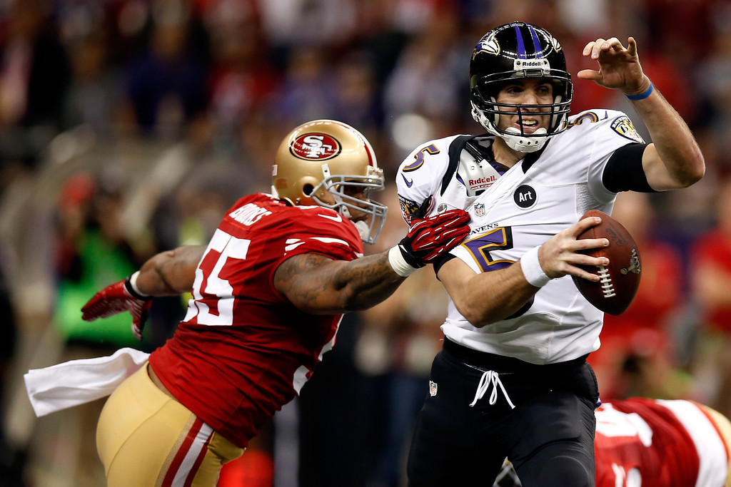 Description of . Joe Flacco #5 of the Baltimore Ravens is pressured and grabbed by  Ahmad Brooks #55 of the San Francisco 49ers in the first quarter during Super Bowl XLVII at the Mercedes-Benz Superdome on February 3, 2013 in New Orleans, Louisiana.  (Photo by Chris Graythen/Getty Images)