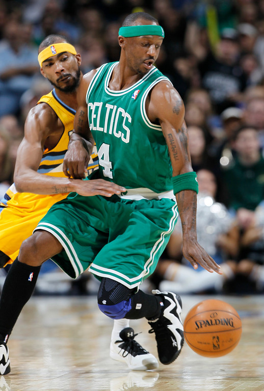 Description of . Denver Nuggets forward Corey Brewer, left, tries to knock ball away from Boston Celtics guard Jason Terry in the fourth quarter of the Nuggets' 97-90 victory in an NBA basketball game in Denver on Tuesday, Feb. 19, 2013. (AP Photo/David Zalubowski)