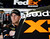 Denny Hamlin waits in his garage next to his car during practice for the NASCAR Daytona 500 Sprint Cup Series auto race at Daytona International Speedway, Wednesday, Feb. 20, 2013, in Daytona Beach, Fla. (AP Photo/John Raoux)