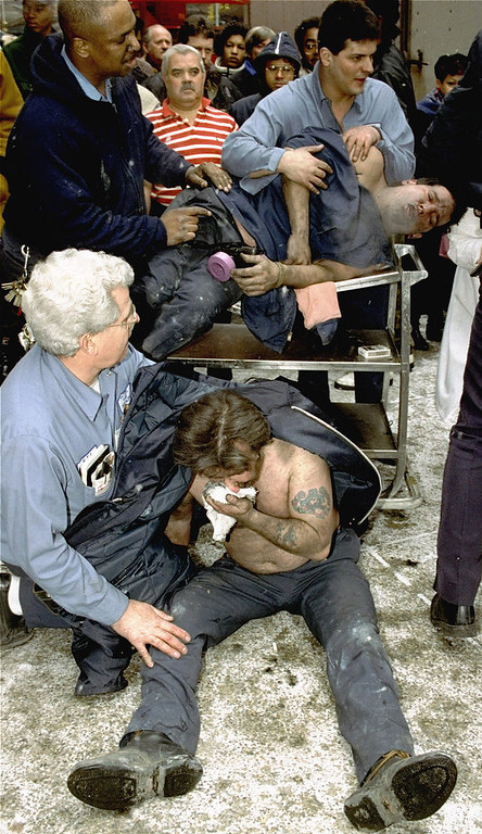 Description of . Victims of a fire at the World Trade Center in New York are treated at the scene after an explosion rocked the complex. A group of terrorists blew up explosives in an underground parking garage under one of the towers, killing six people and ushering in an era of terrorism on American soil. (AP Photo/Marty Lederhandler, File)