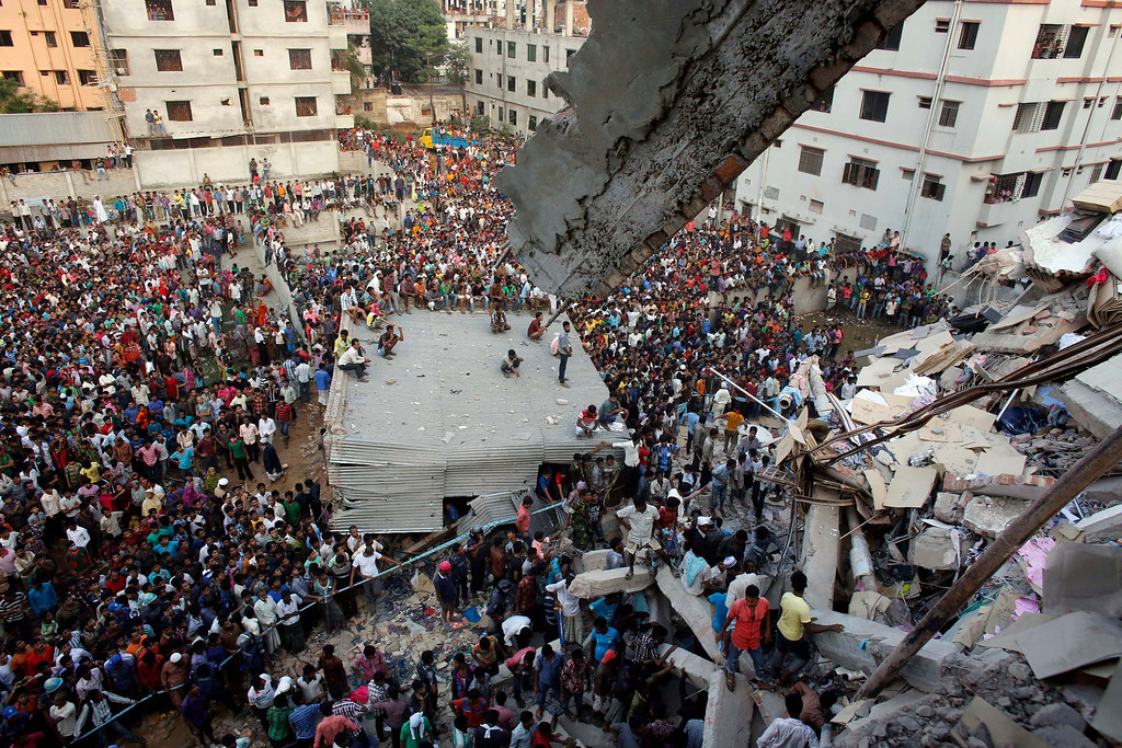 Description of . Rescue workers try to rescue trapped garment workers in the Rana Plaza building which collapsed, in Savar, 30 km (19 miles) outside Dhaka April 24, 2013.REUTERS/Andrew Biraj