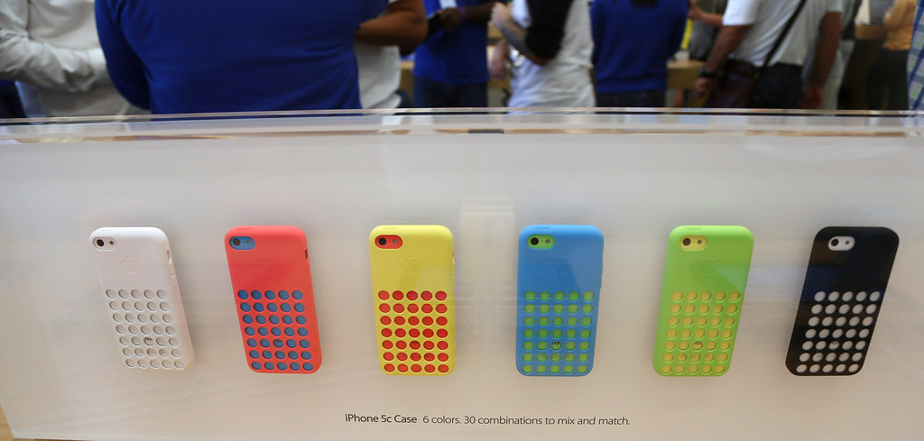 Description of . A row of iPhone 5c phones are on display at the Apple Store on Lincoln Road in Miami Beach, Fla., Friday, Sept. 20, 2013, the first day of sales for the phone. (AP Photo/J Pat Carter)