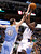 Denver Nuggets center Kosta Koufos (L) blocks the shot of Dallas Mavericks guard Darren Collison during the first half of their NBA basketball game in Dallas, Texas December 28, 2012.  REUTERS/Mike Stone (UNITED STATES - Tags: SPORT BASKETBALL)