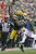 Tom Crabtree #83 of the Green Bay Packers is tackled by Antoine Winfield #26 of the Minnesota Vikings at Lambeau Field on December 2, 2012 in Green Bay, Wisconsin.  The Packers defeated the Vikings 23-14.  (Photo by Wesley Hitt/Getty Images)