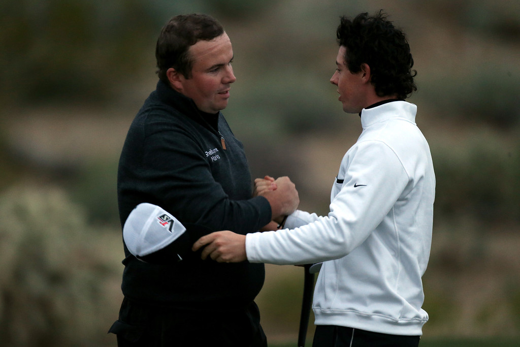 Description of . MARANA, AZ - FEBRUARY 21:  (L-R) Shane Lowry of Ireland is congratulated by Rory McIlroy of Northern Ireland after Lowry won their match 1 up in 18 holes during the first round of the World Golf Championships - Accenture Match Play at the Golf Club at Dove Mountain on February 21, 2013 in Marana, Arizona. Round one play was suspended on February 20 due to inclimate weather and is scheduled to be continued today.  (Photo by Andy Lyons/Getty Images)