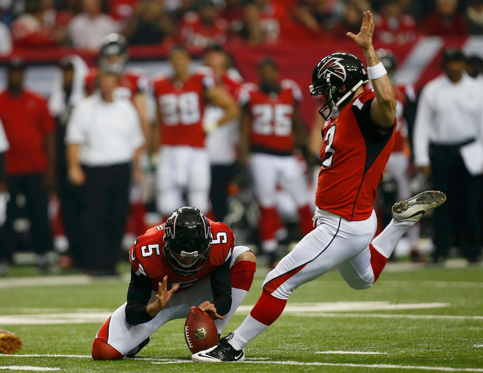 Description of . Atlanta Falcons kicker Matt Bryant kicks a field goal as Matt Bosher holds during the first quarter against the San Francisco 49ers in the NFL NFC Championship football game in Atlanta, Georgia January 20, 2013. REUTERS/Jeff Haynes