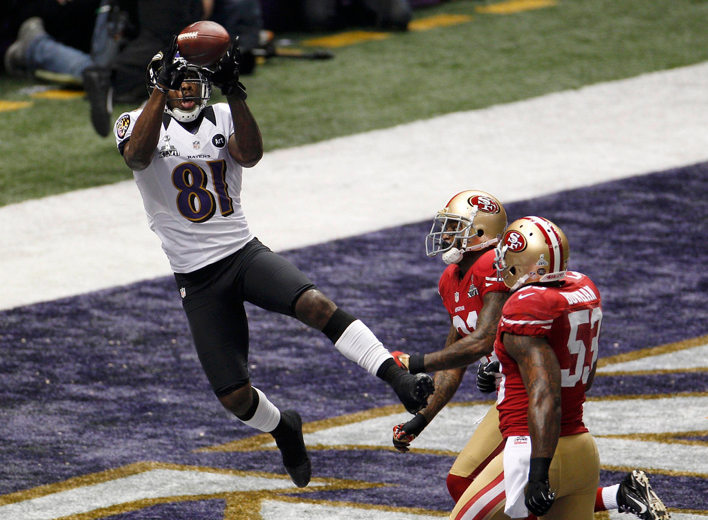 Description of . Baltimore Ravens wide receiver Anquan Boldin (81) catches a touchdown pass against San Francisco 49ers strong safety Donte Whitner (31) and inside linebacker NaVorro Bowman (53) in the first quarter of the NFL Super Bowl XLVII football game in New Orleans, Louisiana, February 3, 2013. REUTERS/Jonathan Bachman