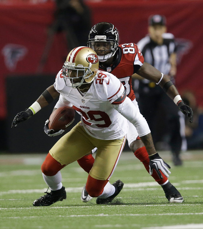 Description of . San Francisco 49ers\' Chris Culliver intercepts a pass in front of Atlanta Falcons\' Harry Douglas (83) during the second half of the NFL football NFC Championship game Sunday, Jan. 20, 2013, in Atlanta. (AP Photo/John Bazemore)