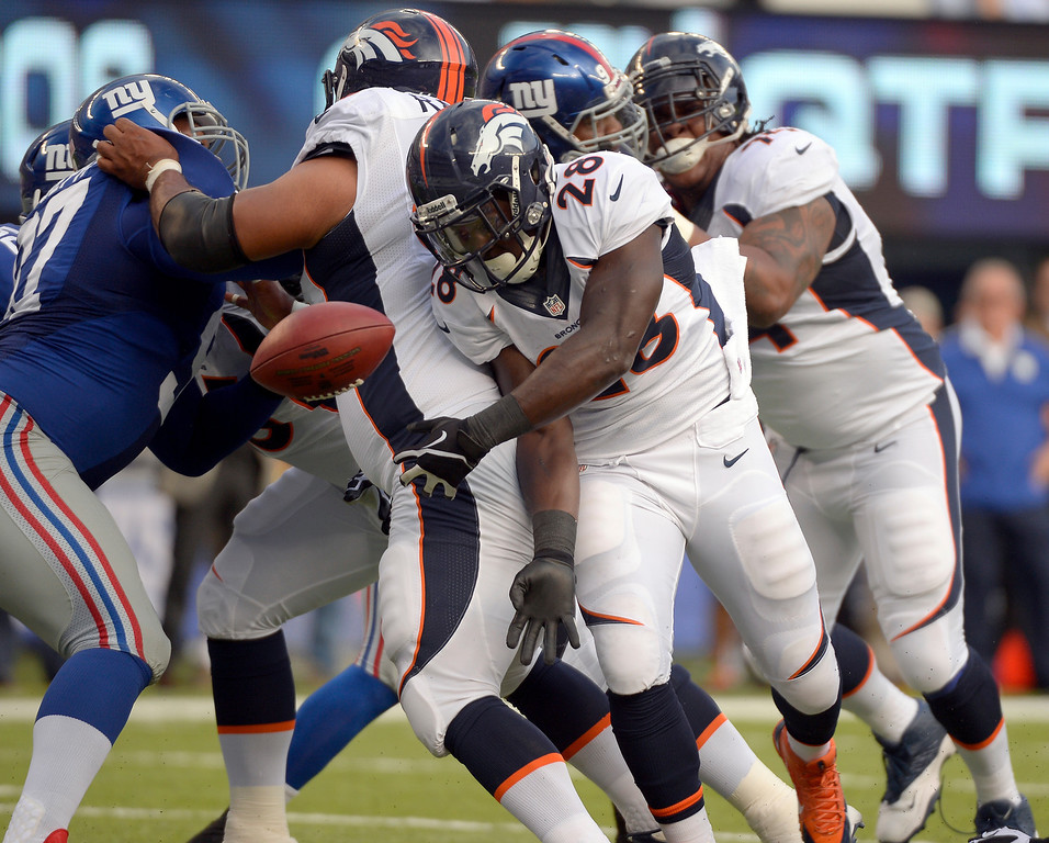 Description of . Running back Montee Ball (28) of the Denver Broncos fumbles the ball at the 3 yard line and recovered by the New York Giants September 15, 2013 MetLIFE Stadium. (Photo by John Leyba/The Denver Post)