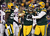 (C) Linebacker Clay Matthews #52 of the Green Bay Packers celebrates with teammates outside linebacker Erik Walden #93 and defensive end Ryan Pickett #79 after Matthews sacks quarterback Joe Webb #14 of the Minnesota Vikings in the first half during the NFC Wild Card Playoff game at Lambeau Field on January 5, 2013 in Green Bay, Wisconsin.  (Photo by Jonathan Daniel/Getty Images)