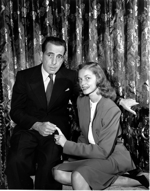 . FILE - This May 1945 file photo shows actor Humphrey Bogart, left, with his wife actress Lauren Bacall. Bacall, the sultry-voiced actress and Humphrey Bogart�s partner off and on the screen, died Tuesday, Aug. 12, 2014 in New York. She was 89. (AP Photo, File)