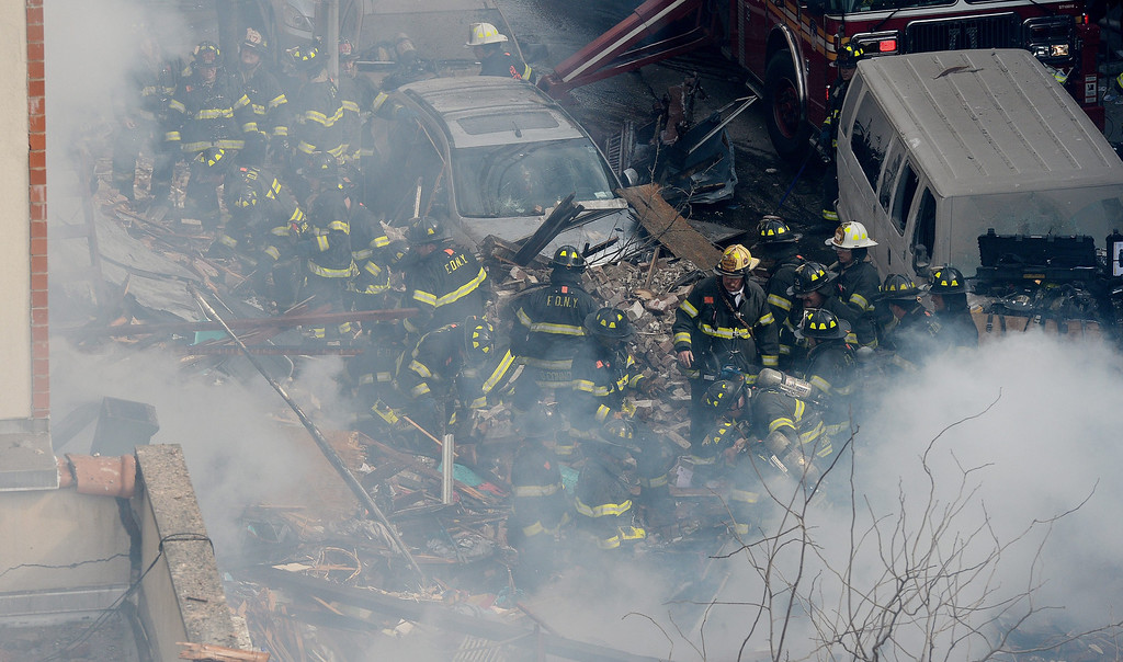 Description of . A view of firefighters on the scene where a group of buildings were damaged nu an explosion in New York, New York, USA, 12 March 2014.  EPA/JUSTIN LANE