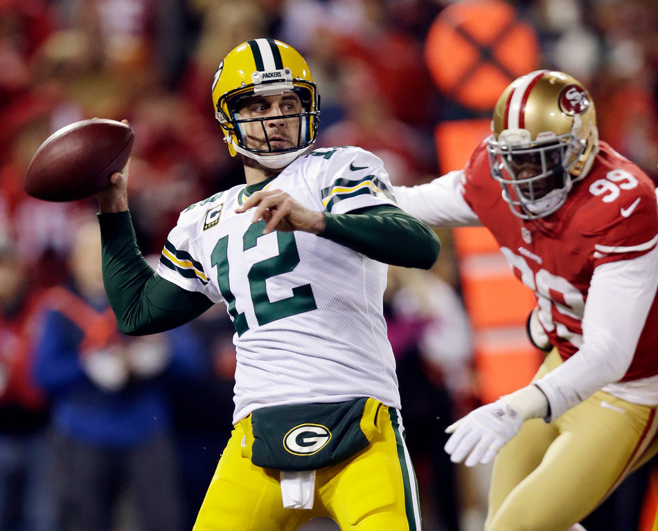 Description of . Green Bay Packers quarterback Aaron Rodgers (12) throws against the San Francisco 49ers during the second quarter of an NFC divisional playoff NFL football game in San Francisco, Saturday, Jan. 12, 2013. (AP Photo/Marcio Jose Sanchez)