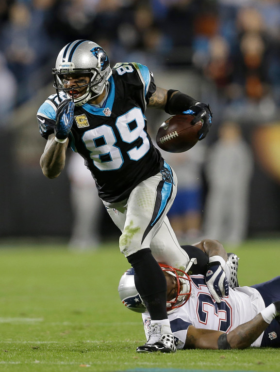 . Carolina Panthers\' Steve Smith (89) is pulled down by New England Patriots\' Aqib Talib (31) during the first half of an NFL football game in Charlotte, N.C., Monday, Nov. 18, 2013. (AP Photo/Gerry Broome)