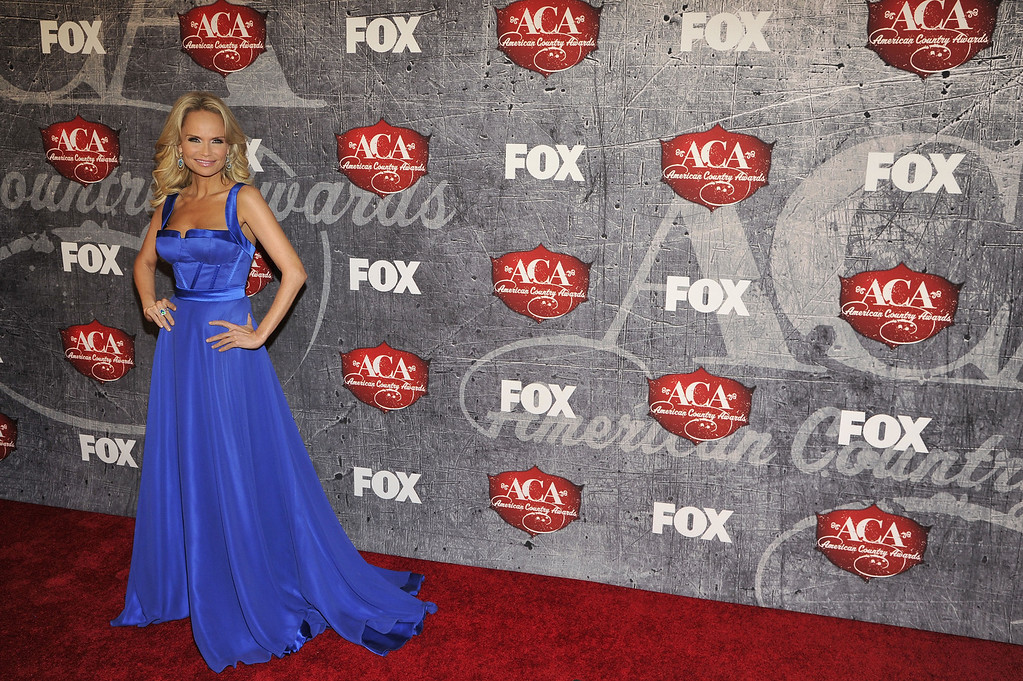 Description of . Co-host Kristin Chenoweth arrives at the American Country Awards on Monday, Dec. 10, 2012, in Las Vegas. (Photo by Jeff Bottari/Invision/AP)