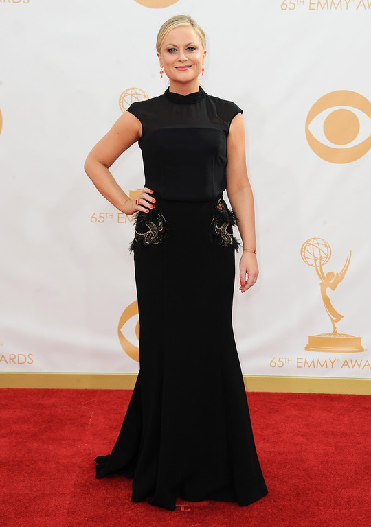 Description of . Amy Poehler arrives at the 65th Primetime Emmy Awards at Nokia Theatre on Sunday Sept. 22, 2013, in Los Angeles.  (Photo by Jordan Strauss/Invision/AP)