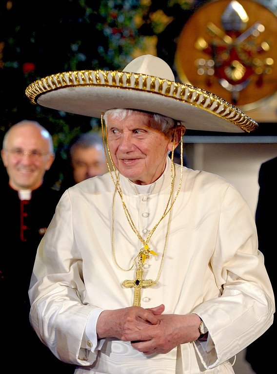 Description of . A file handout picture taken on March 25, 2012 and released by the Osservatore Romano shows Pope Benedict XVI wearing a sombrero in Leon. AFP PHOTO / OSSERVATORE ROMANO