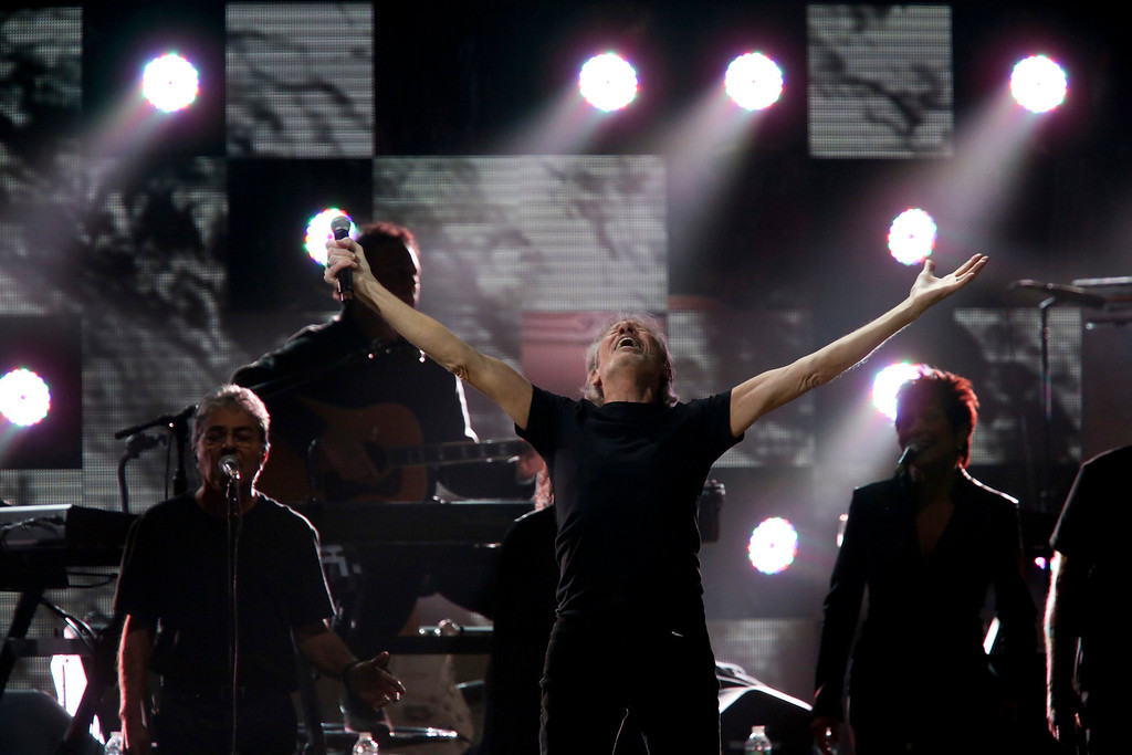Description of . Roger Waters, a founding member of the band Pink Floyd, performs during the 12-12-12 benefit concert for victims of Hurricane Sandy, at Madison Square Garden in New York, Dec. 12, 2012. The concert features a lineup of artists spanning five decades. (Damon Winter/The New York Times)