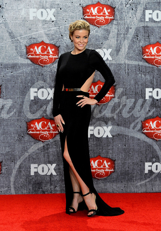 Description of . LAS VEGAS, NV - DECEMBER 10:  Actress Carmen Electra poses in the press room during the 2012 American Country Awards at the Mandalay Bay Events Center on December 10, 2012 in Las Vegas, Nevada.  (Photo by Frazer Harrison/Getty Images)