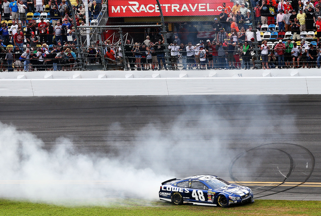 Description of . Jimmie Johnson, driver of the #48 Lowe's Chevrolet, celebrates after winning the NASCAR Sprint Cup Series Daytona 500 at Daytona International Speedway on February 24, 2013 in Daytona Beach, Florida.  (Photo by Matthew Stockman/Getty Images)