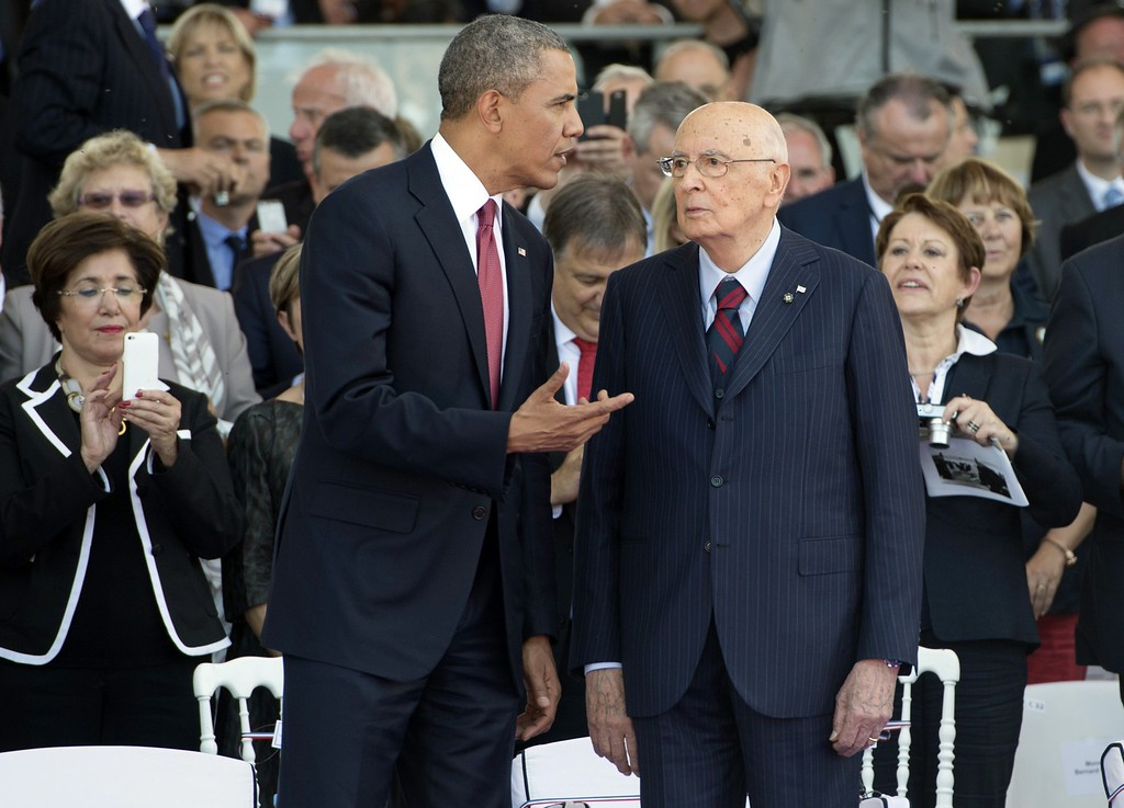 Description of . US President Barack Obama (L) speaks with Italian President Giorgio Napolitano during the Ouistreham International Ceremony at Sword Beach to commemorate the 70th anniversary of the Allied invasion at Normandy, in Ouistreham, France, June 6, 2014.  AFP PHOTO / SAUL LOEB/AFP/Getty Images