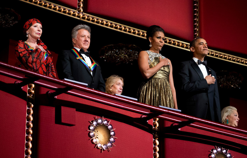 Description of . President Barack Obama, right, and first lady Michelle Obama, second from right, with the 2012 Kennedy Center Honors recipients, ballerina Natalia Makarova, left, and actor and director Dustin Hoffman, stand as the National Anthem is played during the Kennedy Center Honors Gala at the Kennedy Center in Washington, Sunday, Dec. 2, 2012. (AP Photo/Manuel Balce Ceneta)