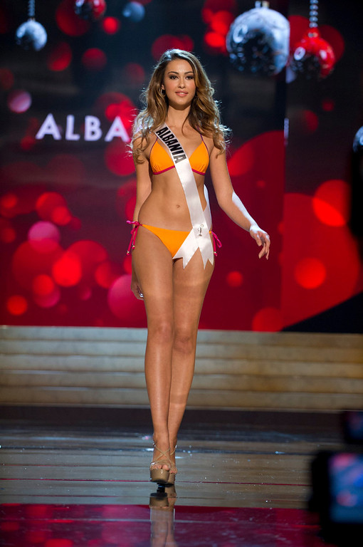 Description of . Miss Albania Adrola Dushi competes in her Kooey Australia swimwear and Chinese Laundry shoes during the Swimsuit Competition of the 2012 Miss Universe Presentation Show at PH Live in Las Vegas, Nevada December 13, 2012. The 89 Miss Universe Contestants will compete for the Diamond Nexus Crown on December 19, 2012. REUTERS/Darren Decker/Miss Universe Organization/Handout