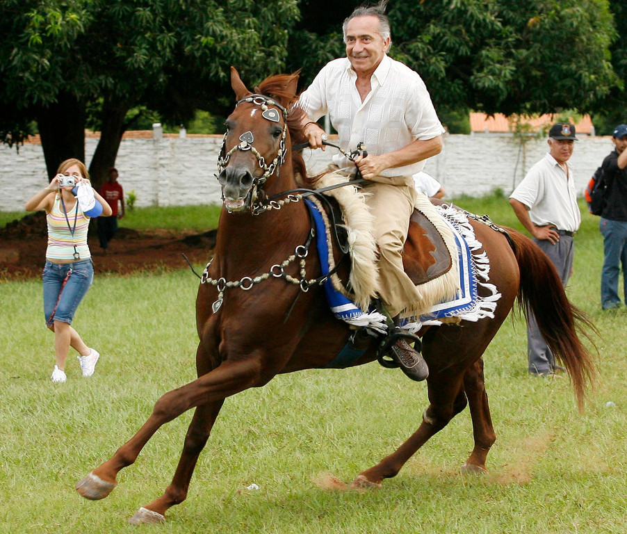 Description of . Lino Oviedo, Paraguayan presidential candidate for the UNASE party, rides a horse during a campaign rally in the city of Yaguaron on February 24, 2008. Oviedo, who led a 1989 coup that overthrew dictator Alfredo Stroessner, died in a helicopter crash over the weekend. Police rescuers found his body on February 3, 2013 in the wreckage of a helicopter crash in northern Paraguay where he was traveling for a campaign event. He was 69. REUTERS/Jorge Adorno/Files