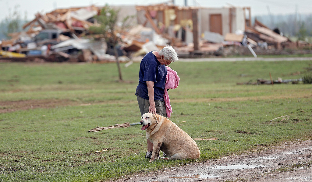. Kay Taylor stands with her dog Bailey in front of her house that was destroyed after the tornado that hit the area near 149th and Drexel on Monday, May 20, 2013 in Oklahoma City, Okla.  (AP Photo/ The Oklahoman, Chris Landsberger)