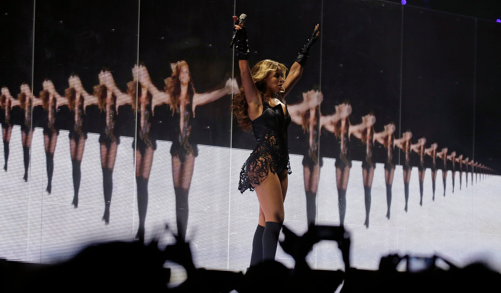 Description of . Beyonce performs during the halftime show of  the NFL Super Bowl XLVII football game between the San Francisco 49ers and the Baltimore Ravens, Sunday, Feb. 3, 2013, in New Orleans. (AP Photo/Matt Slocum)