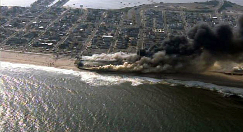 Description of . This frame grab from video provided by Fox 29 shows a raging fire in Seaside Park, N.J. on Thursday, Sept. 12, 2013.  The fire apparently started in an ice cream shop and spread several blocks down  the New Jersey shore boardwalk that was damaged in Superstorm Sandy (AP Photo/Fox 29)