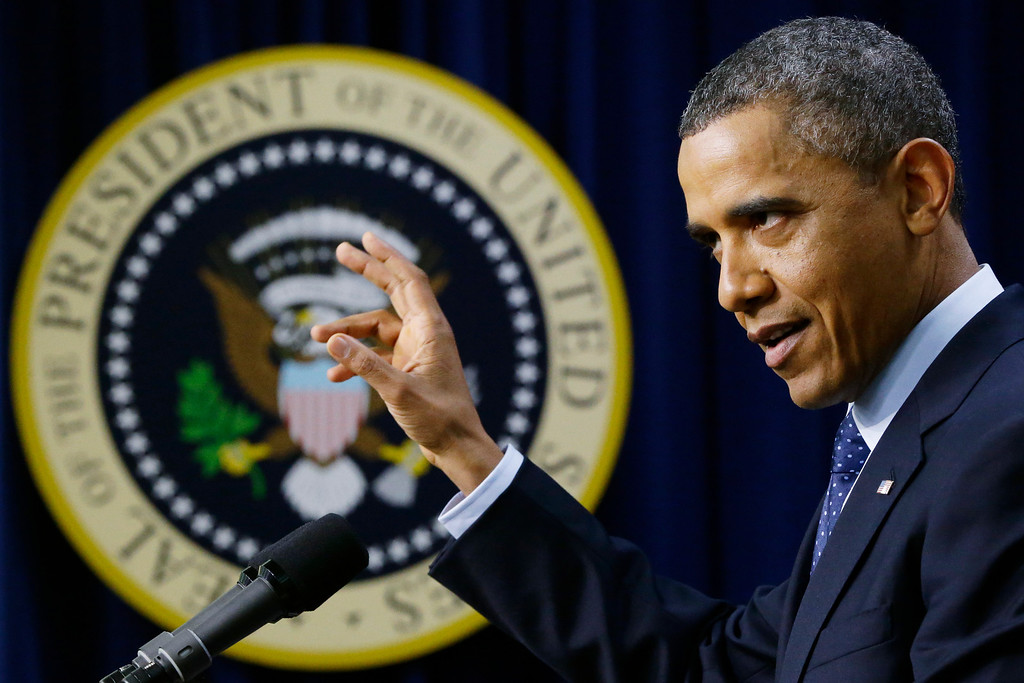Description of . President Barack Obama gestures as he speaks about the fiscal cliff, Monday, Dec. 31, 2012, in the South Court Auditorium at the White House in Washington. The president said it appears that an agreement to avoid the fiscal cliff is