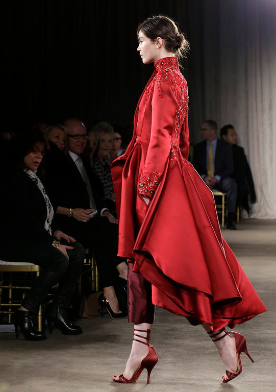 Description of . A model walks the runway during the Marchesa Fall 2013 fashion show during Fashion Week in New York on Wednesday, Feb. 13, 2013.  (AP Photo/Kathy Willens)