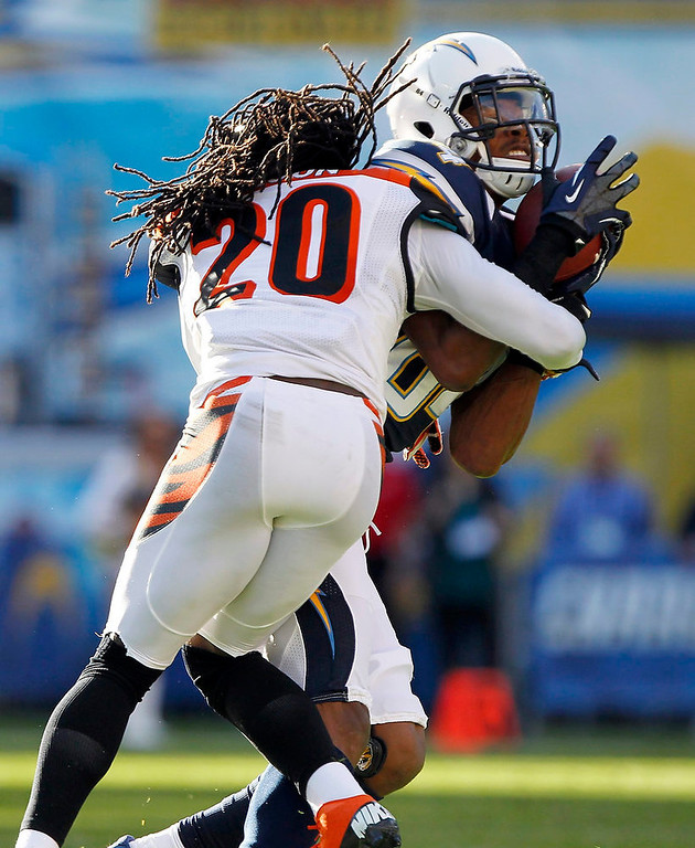 Description of . Cincinnati Bengals free safety Reggie Nelson (20) stops San Diego Chargers wide receiver Danario Alexander (84) after catching a pass for 18 yards in the first half of their NFL football game in San Diego, California December 2, 2012.  REUTERS/Alex Gallardo