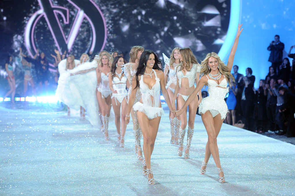 Description of . Models Adriana Lima and Candice Swanepoel walk the runway at the 2013 Victoria's Secret Fashion Show at Lexington Avenue Armory on November 13, 2013 in New York City.  (Photo by Jamie McCarthy/Getty Images)