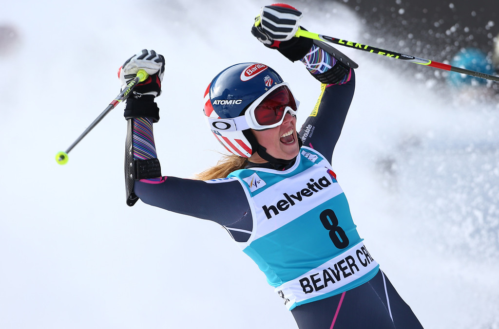 Description of . Mikaela Shiffrin raises her arms after crossing the finish line on her second run during the women's World Cup giant slalom skiing event, in Beaver Creek, Colo., Sunday, Dec. 1, 2013. Shiffrin finished second place. (AP Photo/Alessandro Trovati)