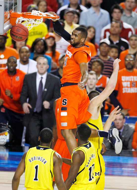 Description of . Syracuse Orange forward James Southerland (43) dunks against the Michigan Wolverines in the second half of their NCAA men's Final Four basketball game in Atlanta, Georgia April 6, 2013.  REUTERS/Tami Chappell