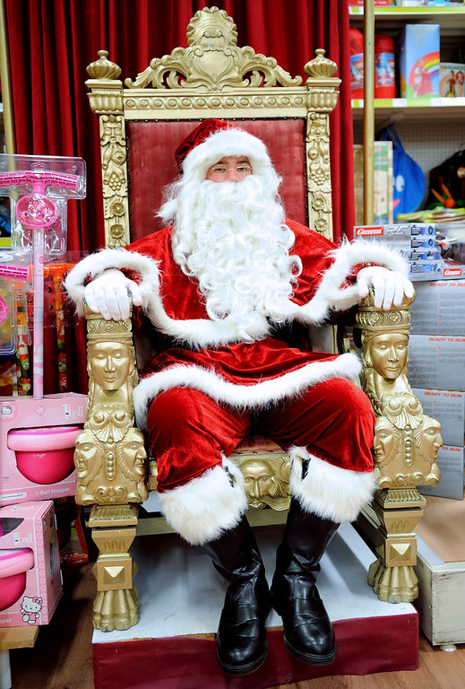 Description of . A Santa Claus sits in a toy store in Lille, northern France, on December 15, 2012.  PHILIPPE HUGUEN/AFP/Getty Images