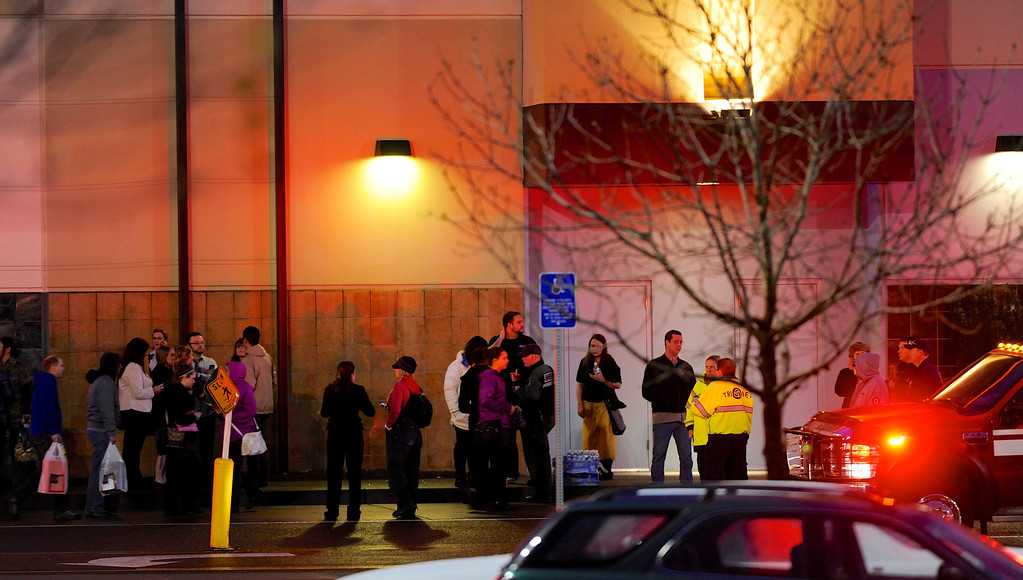 Description of . Shoppers wait to be evacuated outside the scene of a multiple shooting at Clackamas Town Center Mall in Clackamas, Ore., Tuesday Dec. 11, 2012. A gunman is dead after opening fire in the Portland, Ore., area shopping mall Tuesday, killing two people and wounding another, sheriff's deputies said. (AP Photo/Greg Wahl-Stephens)
