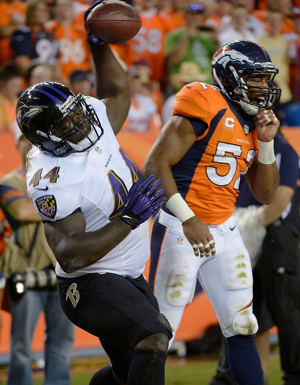Description of . Baltimore Ravens running back Vonta Leach (44) spikes the ball after scoring a touchdown in the first quarter.  (Photo by Joe Amon/The Denver Post)