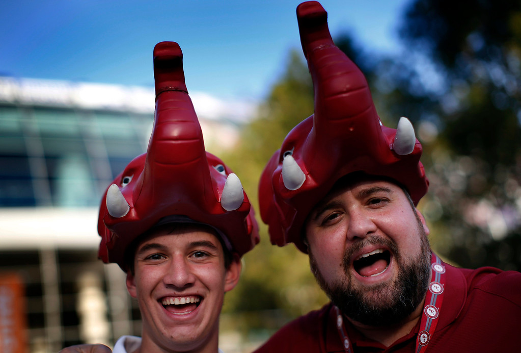 Description of . Alabama Crimson Tide fans wear elephant hats outside Sun Life stadium before the BCS National Championship college football game between Alabama and the Notre Dame Fighting Irish in Miami, Florida January 7, 2013. REUTERS/Mike Segar