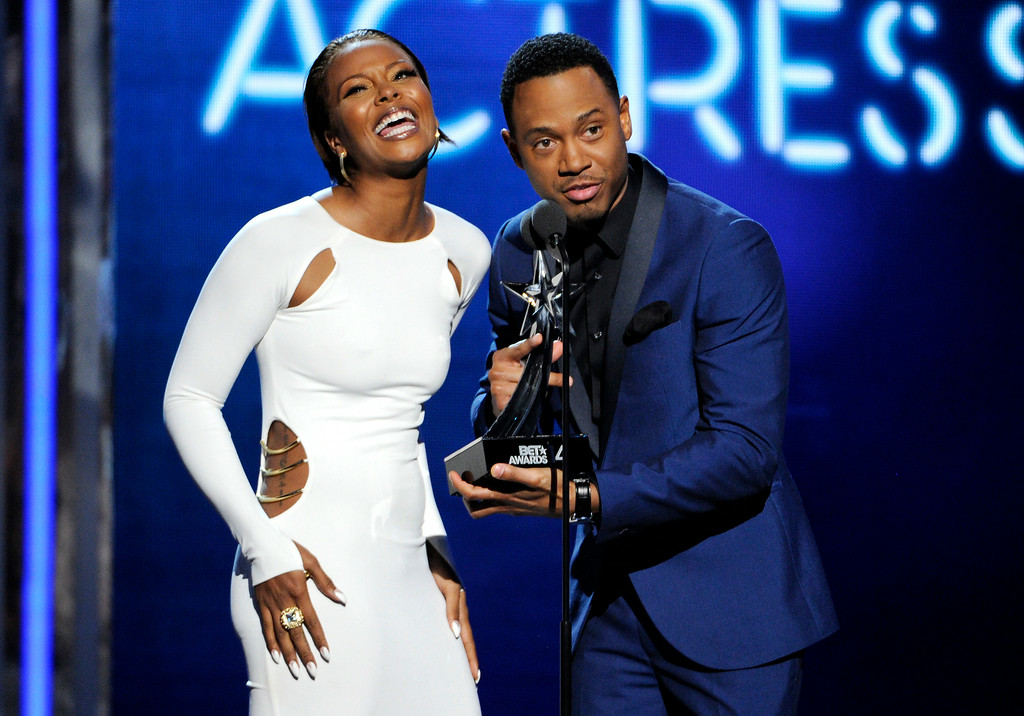 Description of . Eva Marcille, left, and Terrence J present the award for best actress at the BET Awards at the Nokia Theatre on Sunday, June 29, 2014, in Los Angeles. (Photo by Chris Pizzello/Invision/AP)