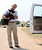 President Bush carries his dog Barney into his pickup truck before driving back to his ranch house, after talking to the press on the ranch in Crawford, Texas on Wednesday, August 13, 2003.  Bush appeared before the press with his team of economic advisors after meeting with them during his August vacation. (AP Photo/Gerald Herbert)