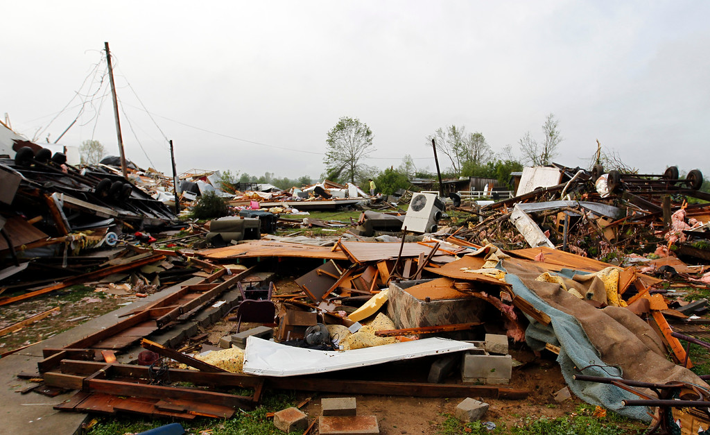 Description of . Residents sift through the debris after a tornado passed through destroying Billy Barbs mobile home park on Tuesday, April 29, 2014, in Athens, Ala.  A dangerous storm system that spawned a chain of deadly tornadoes over three days flattened homes and businesses, forced frightened residents in more than half a dozen states to take cover and left tens of thousands in the dark Tuesday morning.(AP Photo/Butch Dill)