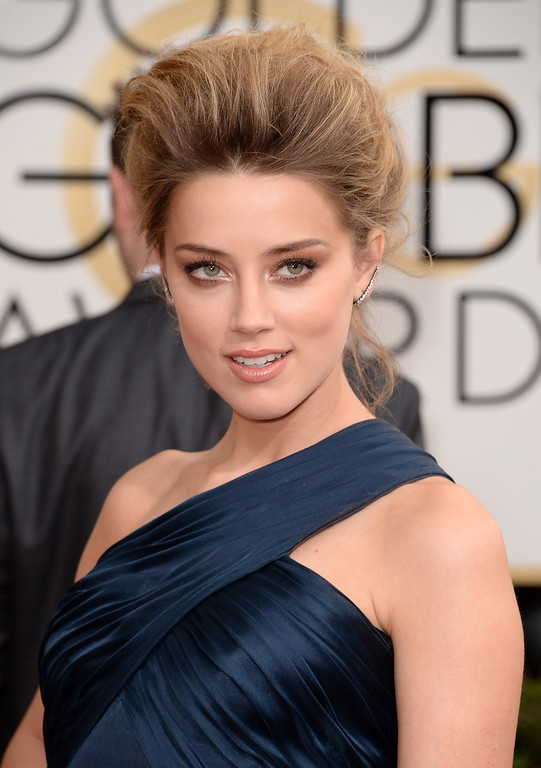 Description of . Actress Amber Heard attends the 71st Annual Golden Globe Awards held at The Beverly Hilton Hotel on January 12, 2014 in Beverly Hills, California.  (Photo by Jason Merritt/Getty Images)