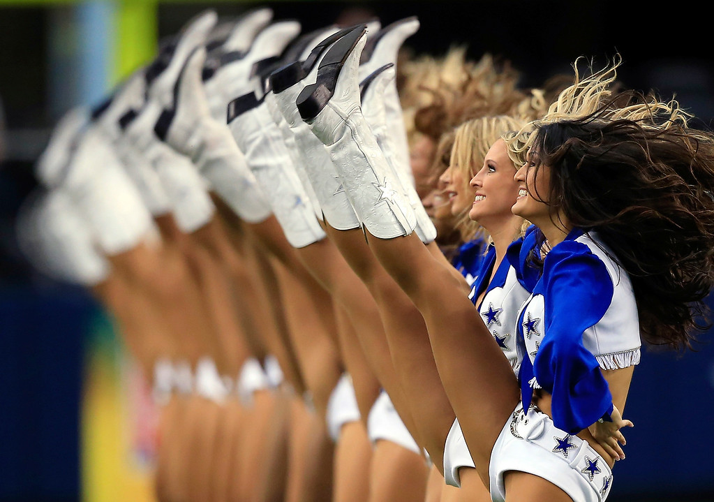 Description of . The Dallas Cowboys cheerleaders perform during the game against the St. Louis Rams at AT&T Stadium on September 22, 2013 in Arlington, Texas.  (Photo by Jamie Squire/Getty Images)